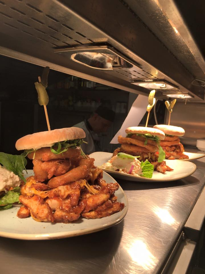 We think this is a massive burger on a bed of wings.