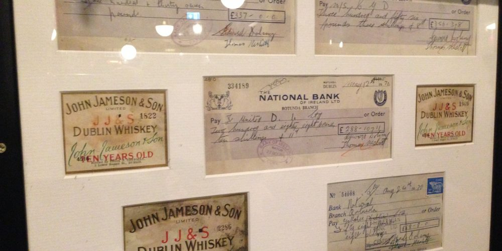 Why are there old framed cheques on the walls of Doheny and Nesbitt?