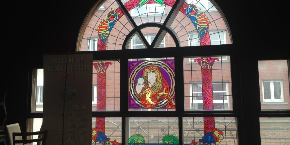 Examples of stained glass artwork in Dublin pubs.