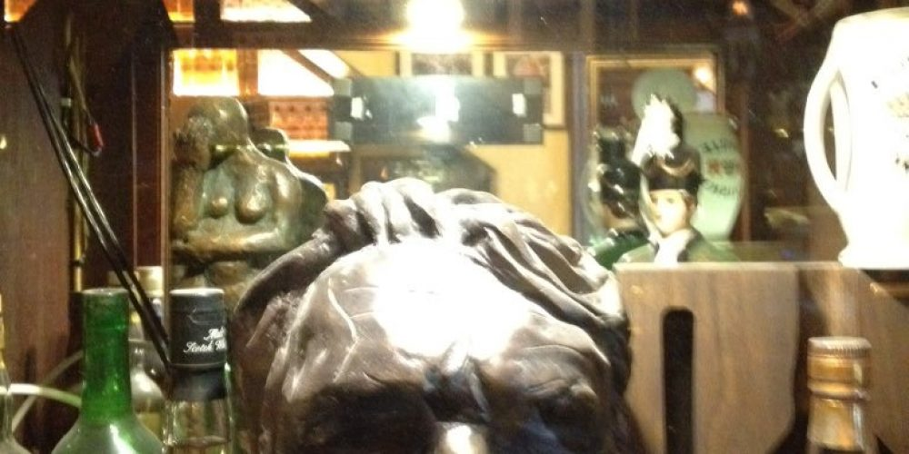 Con Houlihan in the pub. Statues, busts, and paintings.