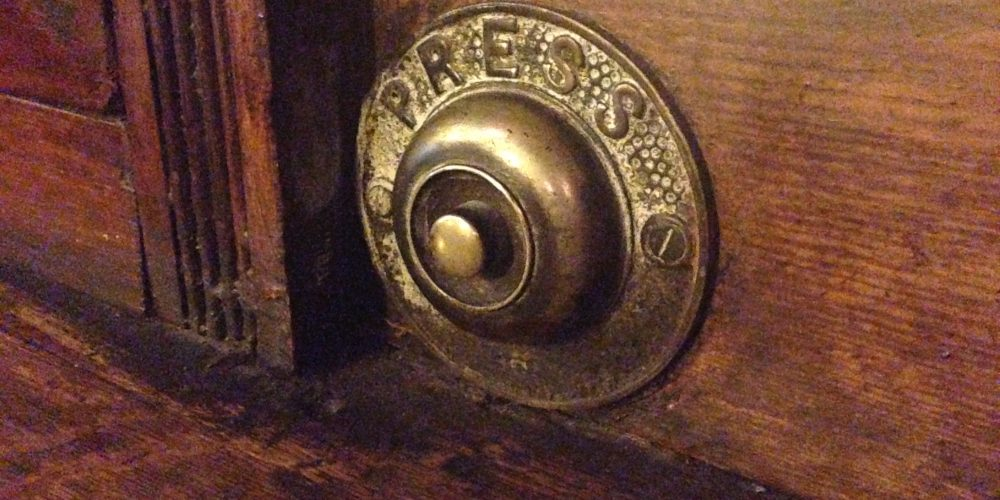 Press for service. When pubs had bells to call the bartender.